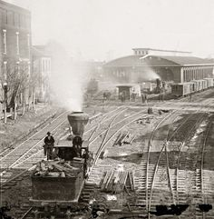 """1864. """"Atlanta, Georgia, railroad yards."""" Wet plate collodion glass negative, left half of stereograph pair, by George N. Barnard"""