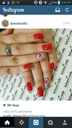 Blood red with stripped accent nail.