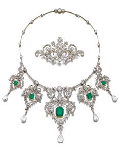 A Belle Epoque emerald and diamond necklace and a diamond brooch, circa 1910. The necklace approximately 410mm long, suspending five detachable pendants, with French assay and maker's marks; the diamond pendant/brooch of similar design from which can be suspended three of the pendants, pendant hooks, French assay mark, additional brooch fittings. #BelleÉpoque #necklace #brooch