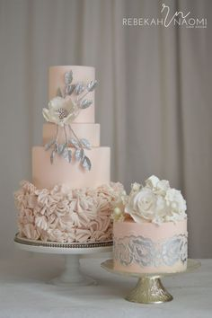 Valentine Wedding Valentine themed wedding cakes in soft blush pink with silver and white accents.