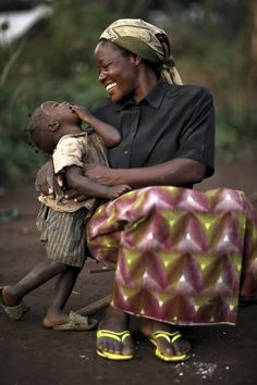 Sister Angelique Namaika, a member of the Augustine Sisters of Dungu & Doruma, embraces a Congolese child at a site for internally displaced people | Aug. 1 in Congo.