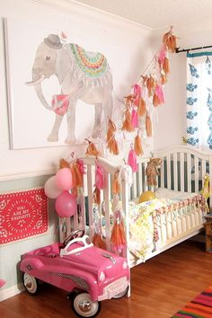 Marlowes Bright Bohemian Room // Very cute room, but I wouldn't tie streamer to the bed though... could be a safety hazard. fixing it to the ceiling & out of reach of young ones is a better way to go.