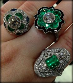 Three glorious emerald and diamond Art Deco rings, one with sapphires and one with black enamel. Via Diamonds in the Library.
