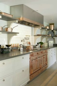Stunning kitchen, white, black & copper details in the hood and hardwaretto name a few!