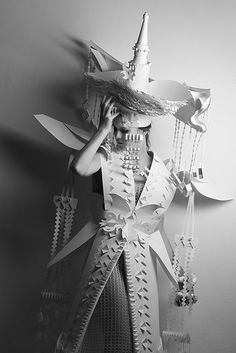 Three girls in paper costumes from paper artist Asya Kozina. Stylized and exaggerated forms of traditional Mongolian costume by artist.