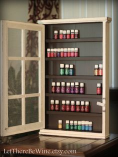 This antique white cabinet with mesh (single door)is custom made to store your essential oils or nail polishes in. This particular cabinet measures 28 high x 18 wide x 3 deep (its a little deeper because of the crystal knob though). It will easily hold (84 of the 15ml essential oils) or (66 of the 30 ml bottles) (ample room to double up on the 5ml bottles to fit 108 of them)and gives you the perfect way to display your oils or nail polishes. The cabinet has 6 shelves measuring 15 1/2 wide by…