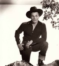 "Publicity photo of Buster as Laramie Nelson in ""Arizona Raiders"" (1936)"
