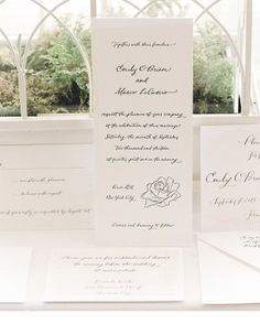 A hand-drawn rose, letterpressed on the ecru invitations, hinted at the verdant venue.