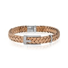 This 18k rose gold woven bracelet is an on-trend piece that can still be worn everyday. An 18k white gold buckle and .66 ctw of diamonds add sparkling accents to this design.