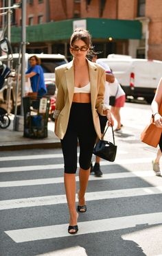 Bra Top Outfits: Emily Ratajkowski wears a bra top with cycling shorts in NYC. Source by outfits chic Models Off Duty, Mode Outfits, Fashion Outfits, Emily Ratajkowski Style, Fashion Week, Fashion Trends, Nyc Fashion, Mein Style, Bra Tops