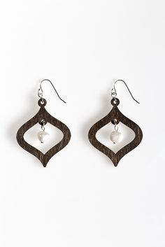 Wood Drop Earrings with Freshwater Pearls- Freshwater pearls hang from the middle of wooden drops which hang from sterling silver filled ear hooks. Fresh Water, Jewelry Collection, Indigo, Drop Earrings, Pearls, Sterling Silver, Trending Outfits, Wood, Unique Jewelry