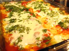 My mother's homemade manicotti recipe with Italian sausage and ricotta cheese. Guaranteed crowd pleaser!