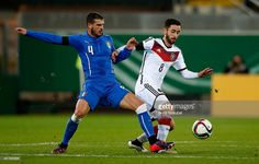 Yunus Malli of Germany is challenged by Stefano Sturaro of Italy during the U21 International...