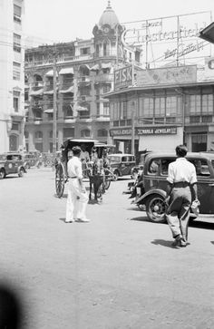 Philippines, busy street with cars, carriages, and shops in Manila Filipino Architecture, Philippine Architecture, Philippines Culture, Manila Philippines, Treaty Of Paris, President Of The Philippines, The Spanish American War, Philippine Art, Filipino Culture