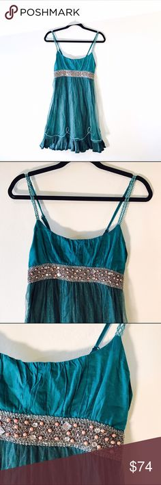 "SALE FINAL $ FREE PEOPLE TURQUOISE DRESS #676 FREE PEOPLE, embellished turquoise dress. Lace shell. Size 4. CONDITION: EUC No issues.  CHEST: 28"" WAIST: 25"" LENGTH: 28"" INSEAM:  *All measurements taken while item is laid flat (doubled when necessary) and measured across the front  MATERIAL: Cotton Nylon  STRETCH: None INSTAGRAM @ORNAMENTALSTONE 🚫Trading ***SALE PRICE IS FINAL NO IFFERS PLEASE*** Free People Dresses Mini"
