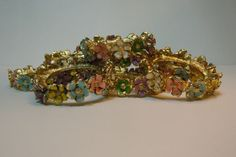 Enamel Flower Gold Napkin Rings Set of 10 by VieuxVintageBoutique on Etsy https://www.etsy.com/listing/263023705/enamel-flower-gold-napkin-rings-set-of