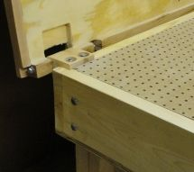 Add a sanding table to the assembly table with hinged top for when not in use.