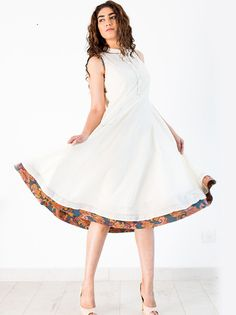 A LINE DRESS - Set an impressive dress trend for the season wearing this White Flowy A Line Dress.This stylish dress is perfect for summers. It will look vibrantly beautiful with a pair of embellished sandals