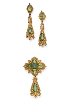 A SET OF ANTIQUE PERIDOT AND GOLD JEWELRY   Comprising a brooch, centering upon an octagonal-cut peridot, flanked on each side by rectangular-cut peridot, within a sculpted gold surround, suspending a detachable pendant of similar design; and a pair of ear pendants en suite, mounted in gold, circa 1840, in a fitted brown leather retailer's cas