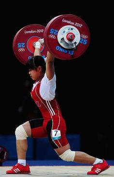 Beauty. Look at that stance. The focus. The stability. The bloody calf muscles! Wow. Olympics2012- weightlifting (53kg)  19 year old, zulfiya chinshanlo, breaks her own world record in the clean and jerk lifting 131kg (~289lbs).