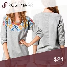 Grey SWEATSHIRT Grey Sweatshirt with Printed Detail at Neckline. This top has a loose, slouchy fit that is perfect to throw on with leggings or your favorite sweats!!  🌟🌟Item is Brand New, direct from the Manufacturer, & Sealed in Pkg. 🌟🌟 Tops Sweatshirts & Hoodies