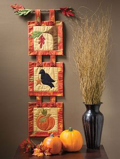Exclusively Annie's Quilting Designs - A cute fall-themed trio to add to your autumn decoration. When displayed together, these three mini quilts make the perfect wall hanging to fill that long narrow spot on the wall. Finished size is x 36 Halloween Quilts, Fall Sewing Projects, Quilting Projects, Autumn Decorating, Fall Decor, Couture Pour Halloween, Quilt Inspiration, Skinny Quilts, Quilt Display