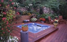 This deck is made out of mahogany, protected with Thompson's Water Seal Advanced Natural Wood Protector. Outdoor Tub, Outdoor Decor, Hot Tub Deck, Deck Pictures, New Deck, Solar Powered Lights, Pool Landscaping, Cool Plants, Courtyards