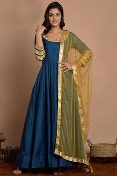 Be the cynosure of all eyes by wearing this Sea blue art silk anarkali suit which will surely make a standout addition at every party you go. This round neck and 3/4th sleeve anarkali suit highlighted with sleeve border work. Matched with lycra/santoon churidar in sea blue color with gold net dupatta. Churidar has plain. Dupatta beautified with lace work. #anarkalisuit #usa #Indianwear #Indiandresses #andaazfashion