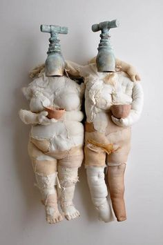 Hefty fabric dolls with faucet heads