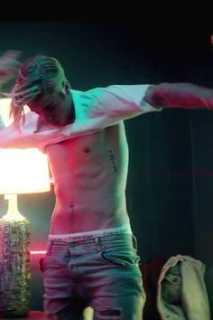 Justin Bieber wearing  Calvin Klein Stretch Cotton Trunk Boxer, Wild Ones Vintage 1970's Vintage White V-Neck T-Shirt, En Noir 5-Pocket Distressed Light Wash Denim Jeans