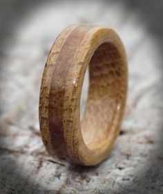 Oak and amber wooden wedding ring.