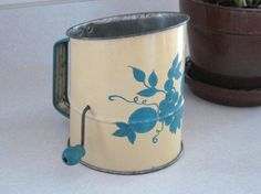 Blue patterned crank flour sifter.