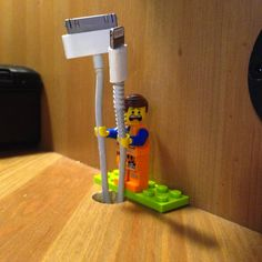 Turns out Lego people have the perfect size hands for phone .-Turns out Lego people have the perfect size hands for phone charges. Up cycle un… Turns out Lego people have the perfect size hands for phone charges. Up cycle unused Lego pieces. Deco Lego, Lego Hand, Lifehacks, Sugru, Cord Holder, Charger Holder, Phone Holder, Lego People, Home Hacks