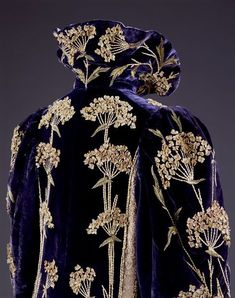 Coat  Place of origin: England, Great Britain (made)  Date: 1895-1900 (made)  Artist/Maker: Marshall and Snelgrove Ltd (maker)  Materials and Techniques: Embroidered velvet with silks, satin, felt, machine-made lace, lined with silk, canvas, metal  Museum number: T.49-1962 | V&A