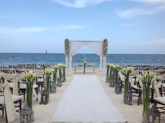 Lilies add a soft touch to a beach ceremony #DreamsRivieraCancun