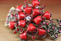 This vintage barrette features vibrant red gemstones and rhinestones with a central floral design. The bold red stones are what give this piece Red Stones, Barrette, Hair Clips, Floral Design, Vibrant, Hair Accessories, Vintage, Claw Hair Clips