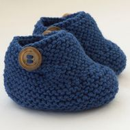 These smart little ankle booties have been knitted with lovely 55% wool blend Patons yarn in dark denim blue. They are fastened with two brown mottled buttons on each bootie. They are light and comfortable. Just right for wearing in the buggy or car...