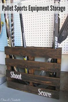 Turn an old pallet into sports equipment storage!  Pefect for hockey sticks…