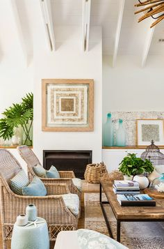 Love the seaside feel from the colour palette, artwork and decor. www.aftershocksinteriordecorating.com