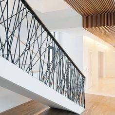 DESIGN DETAIL – Random Railings - This home designed by Monoloko Design, features custom railings on the stairs and the top floor, made from randomly placed steel supports that have been powder coated black. - Luxury Homes