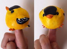 Yellow Goldfinch Bird Finger Puppet Sculpture.