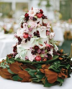 Lauren Bohl-White of A White Cake adorned Sarah and Tom's wedding confection with marzipan and sugar pomegranates and foliage.