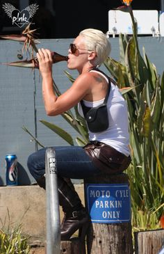 P!NK , drinking a beer