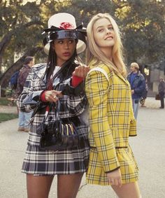 """Dionne (played by Stacey Dash) and Cher (played by Alicia Silverstone) in Clueless Costume Design by Mona May. From an article listing of the Most Iconic Movie Outfits of All Time"""". Clueless Costume, Clueless Outfits, Clueless Fashion, Clueless 1995, Clueless Style, Movie Outfits, Clueless Cher And Dionne, Cher Costume, Fashion Clothes"""