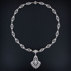 An absolutely stunning transitional style - late Edwardian / early Art Deco - platinum and diamond necklace signed Cartier. Circa 1929