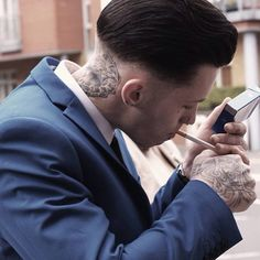 Love this photo caught of me having a crafty cigarette at last weeks wedding by the photographer @misstonks very skillful with her camera  #nofilter #alternative #cigarette #wedding #photography #crafty #suit #headtattoo #handtattoo #inked #guyswithink #camera #photographer #barber #barberlife #tattoo #lowblend #dark #dtphotography