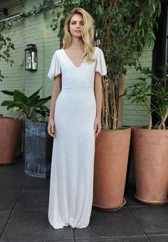 Sarah Seven sparkly beaded wedding dress with v-neckline and flutter sleeves Fall 2016 | https://www.theknot.com/content/sarah-seven-wedding-dresses-bridal-fashion-week-fall-2016