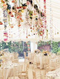 Magical wedding reception | All white tables + chairs with hanging flower decor