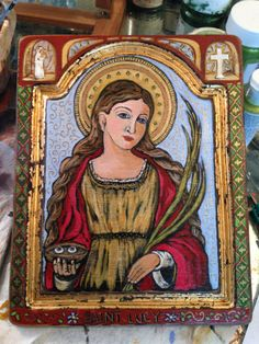 This is Saint Lucy - I just completed her and she will be available for sale in my etsy store - - she is an original 8 x 10 painted directly on a wooden board with her story on the back! Santa Lucia, St John Bosco, St Monica, Lost Pictures, Saint Dominic, St Clare's, Artwork Images, Catholic Saints, Mexican Folk Art