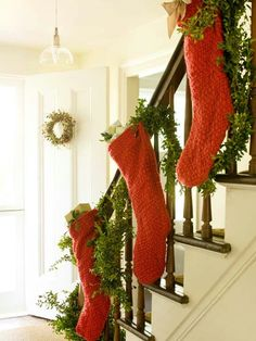 If you live in a house where you don't have a fireplace or mantle to hang your stockings from, the stair railing makes a great alternative!